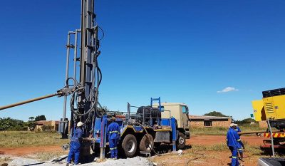 workers operating a drill truck